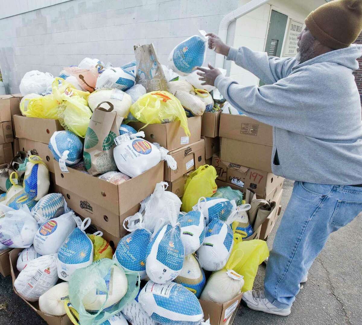 United Way is organizing a campaign to raise money for free Thanksgiving meals for families in need. Pictured: Volunteer Arthur James, of Danbury, organizes frozen turkeys for Thanksgiving Food Distribution at the Daily Bread Food Pantry in Danbury. Monday, Nov. 20, 2017