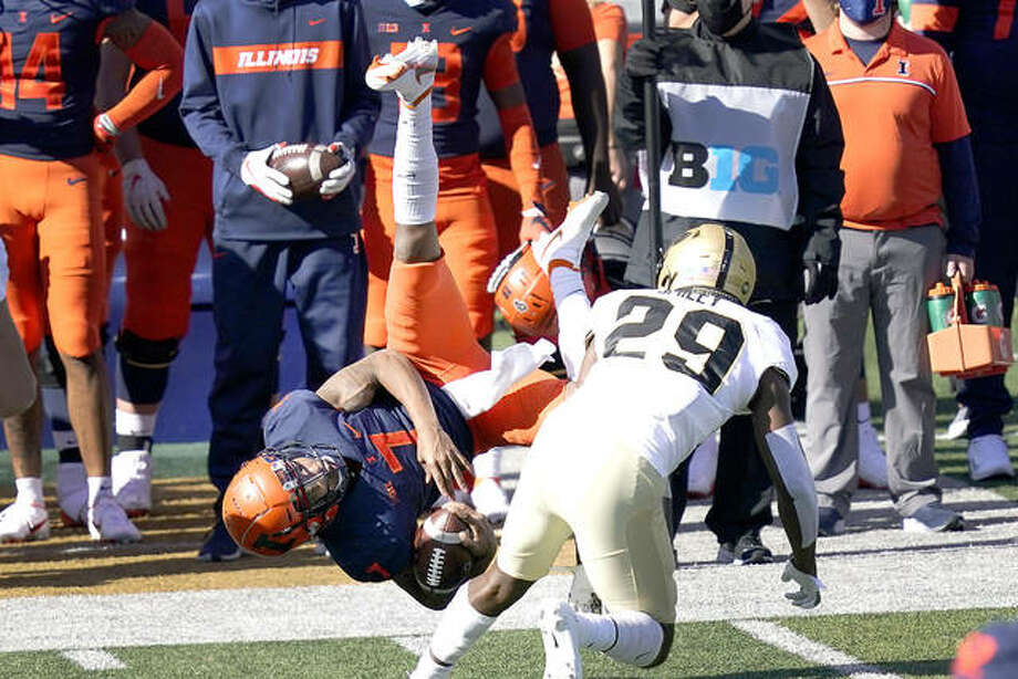 Illinois quarterback Coran Taylor (7) is upended by Purdue cornerback Simeon Smiley during Saturday's game in Champaign. Photo: AP Photo