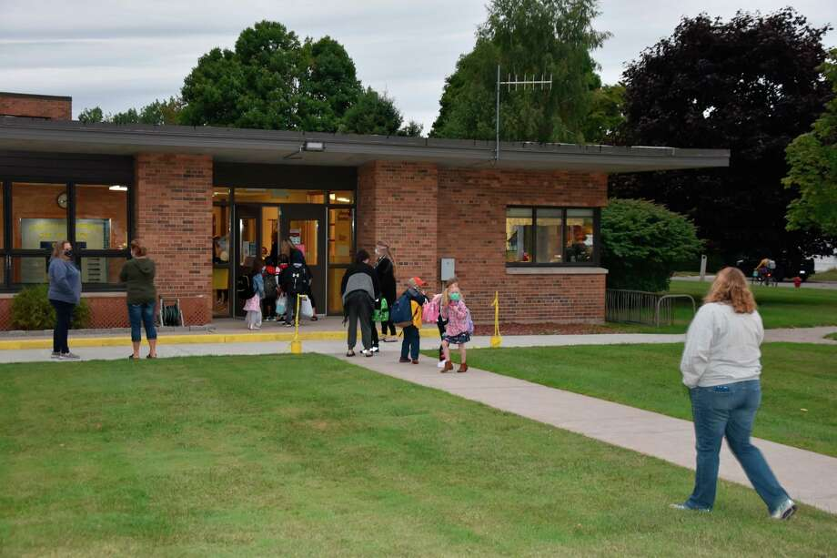 Students enter Jefferson Elementary on the first day of school on Sept. 8. The Michigan Department of Health and Human Services moved Manistee County's region from Phase 5 into Phase 4 last week. Manistee Area Public Schools had already been operating under Phase 4 guidelines because the district extends into Mason County. (File photo)
