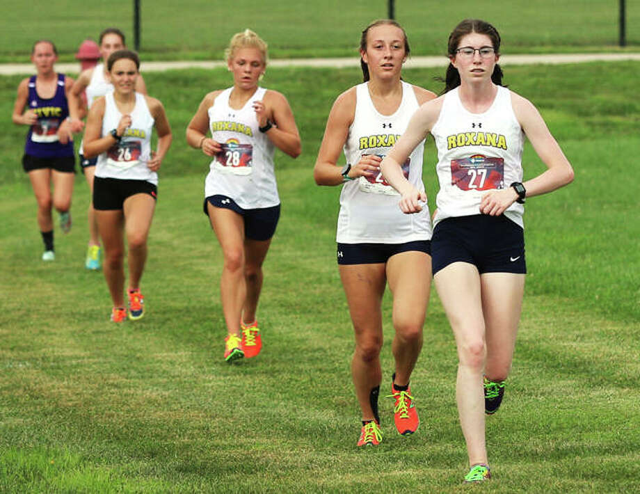 Roxana falls in line with (from front) Riley Doyle, Janelynn Wirth, Zoey Losch , Keiko Palen and Zoey Losch running ahead of CM's Hannah Meiser in a dual meet Aug. 26 at the Bethalto Sports Complex. All six runners will finish their season this weekend at the ShaZam Racing 2020 XC Championships in Chillicothe. Photo: Greg Shashack / The Telegraph