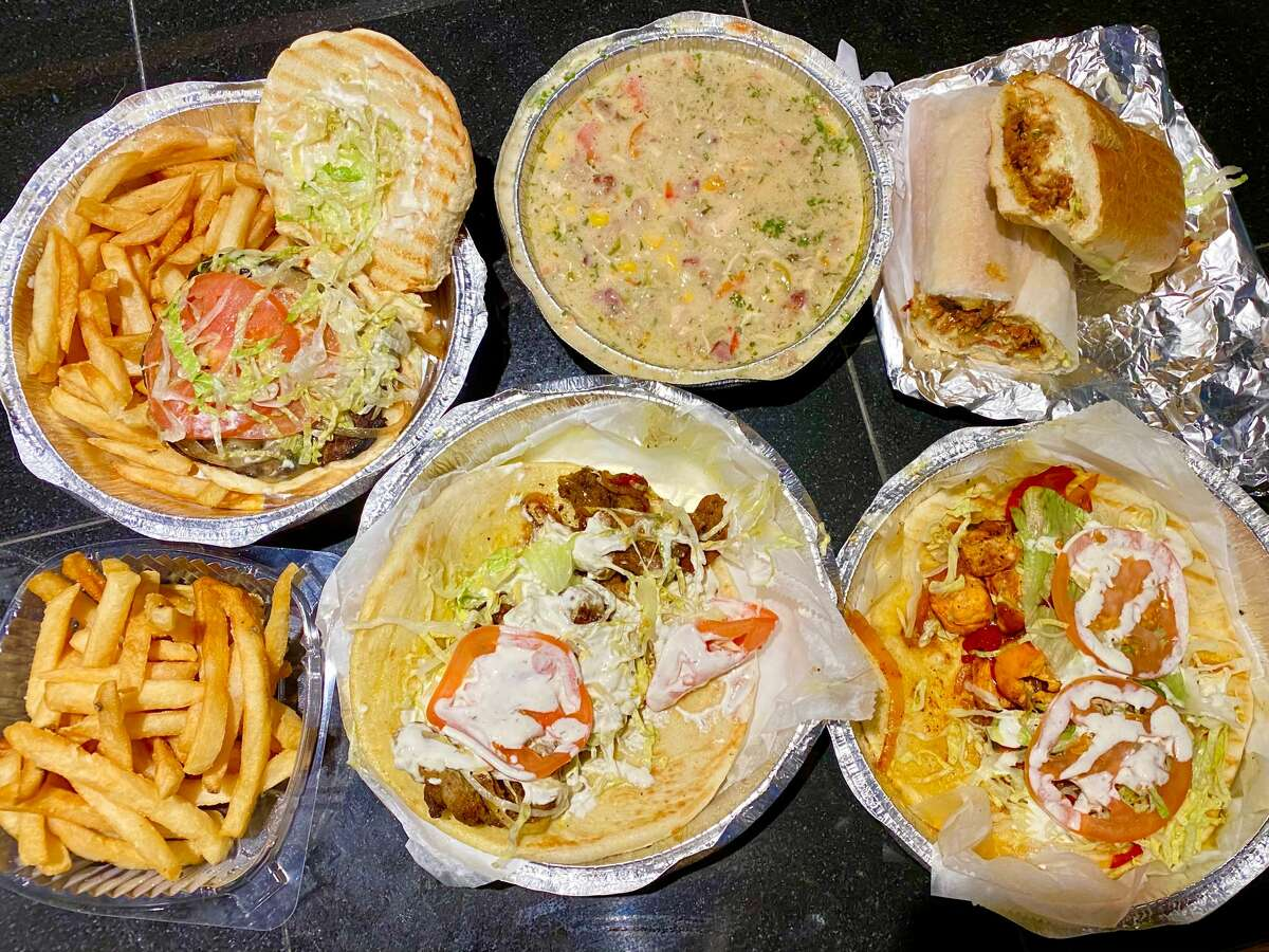 An array of to-go food from Shebamz Grill in Albany. (Susie Davidson Powell for the Times Union.)