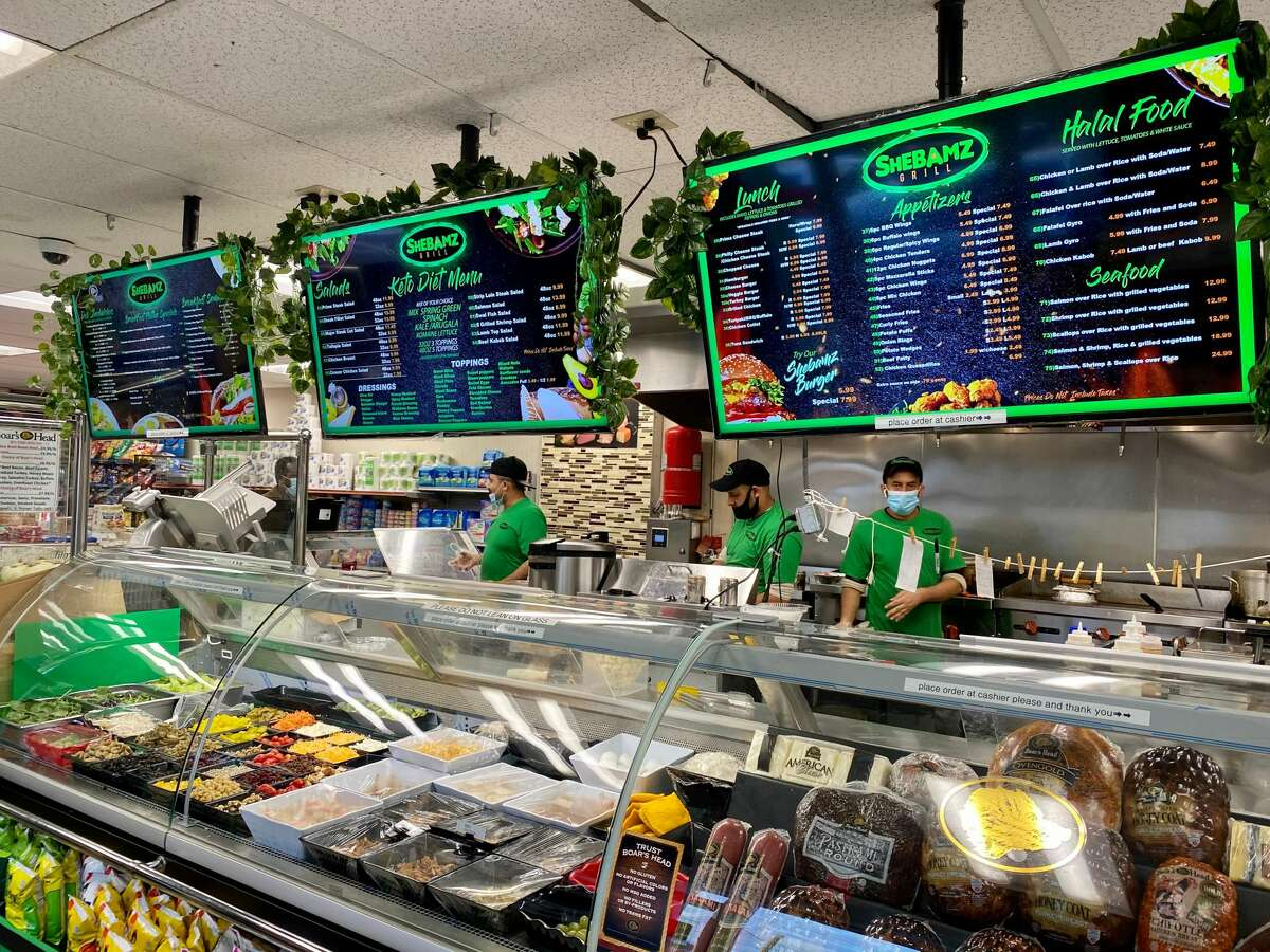 Menu boards and the food counter of Shebamz Grill in Albany. (Susie Davidson Powell for the Times Union.)