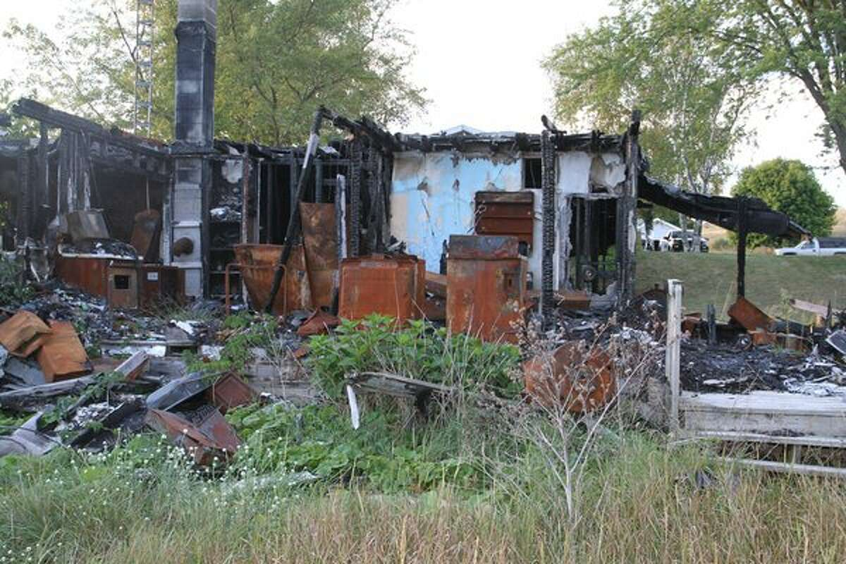A fire destroyed this home at 6039 Miller Road in Manistee Township. It is one of several foreclosed properties that have been put up for auction by the county. (Courtesy Photo)
