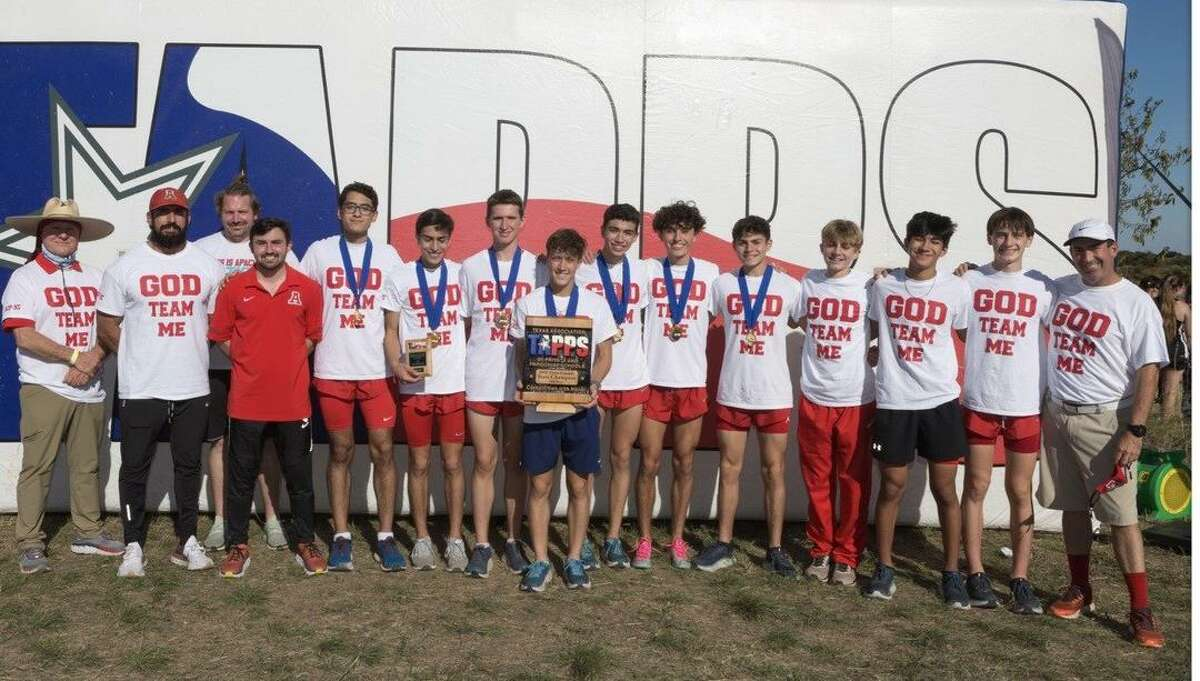 Members of Antonian's boys cross country team pose with the TAPPS Class 6A championship trophy it captured on Monday at Waco Midway High School.