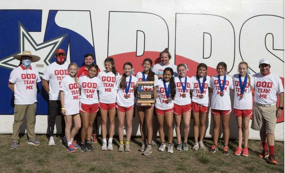 Members of Antonian's girls cross country team pose with the TAPPS Class 6A championship trophy it captured on Monday at Waco Midway High School.