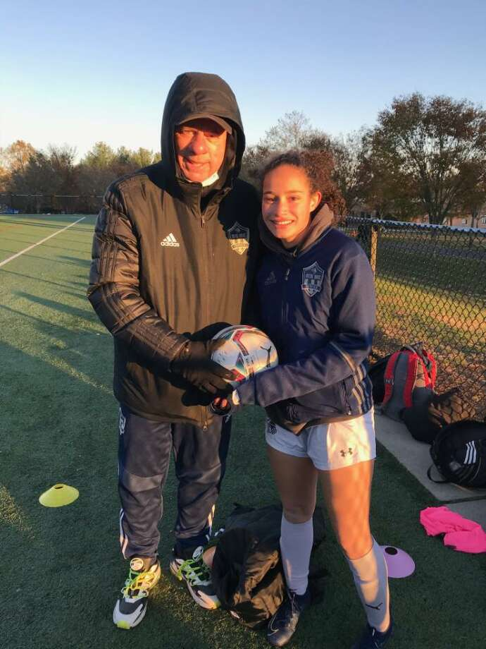 Toni Domingos, right, became Notre Dame-Fairfield's all-time leading scorer on Monday, Nov. 2, 2020. At left is Notre Dame coach Wayne Mones. Photo: Submitted Photo
