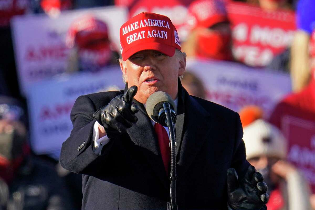 President Donald Trump gestures while addressing a campaign rally at the Wilkes-Barre Scranton International Airport in Avoca, Pa, Monday. Trump made five stops Monday, including one in Traverse City. (AP Photo/Gene J. Puskar)