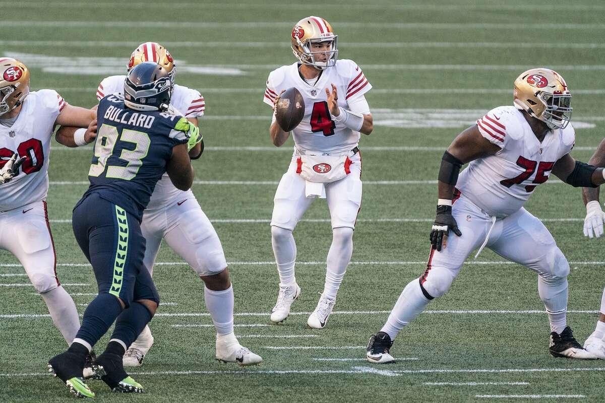 San Francisco 49ers quarterback Nick Mullens looks to pass during the second half of an NFL football game against the Seattle Seahawks, Sunday, Nov. 1, 2020, in Seattle. Mullens replaced Jimmy Garappolo after the 49ers' starter was removed from the game. The Seahawks won 37-27.