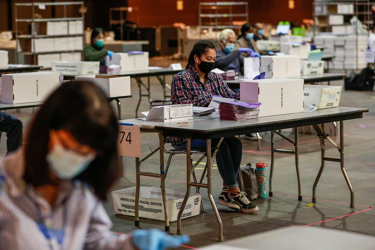 Sophia Lee helps with ballot sorting ahead of Election Day at the Bill Graham Civic Auditorium on Monday, Nov. 2, 2020 in San Francisco, California.