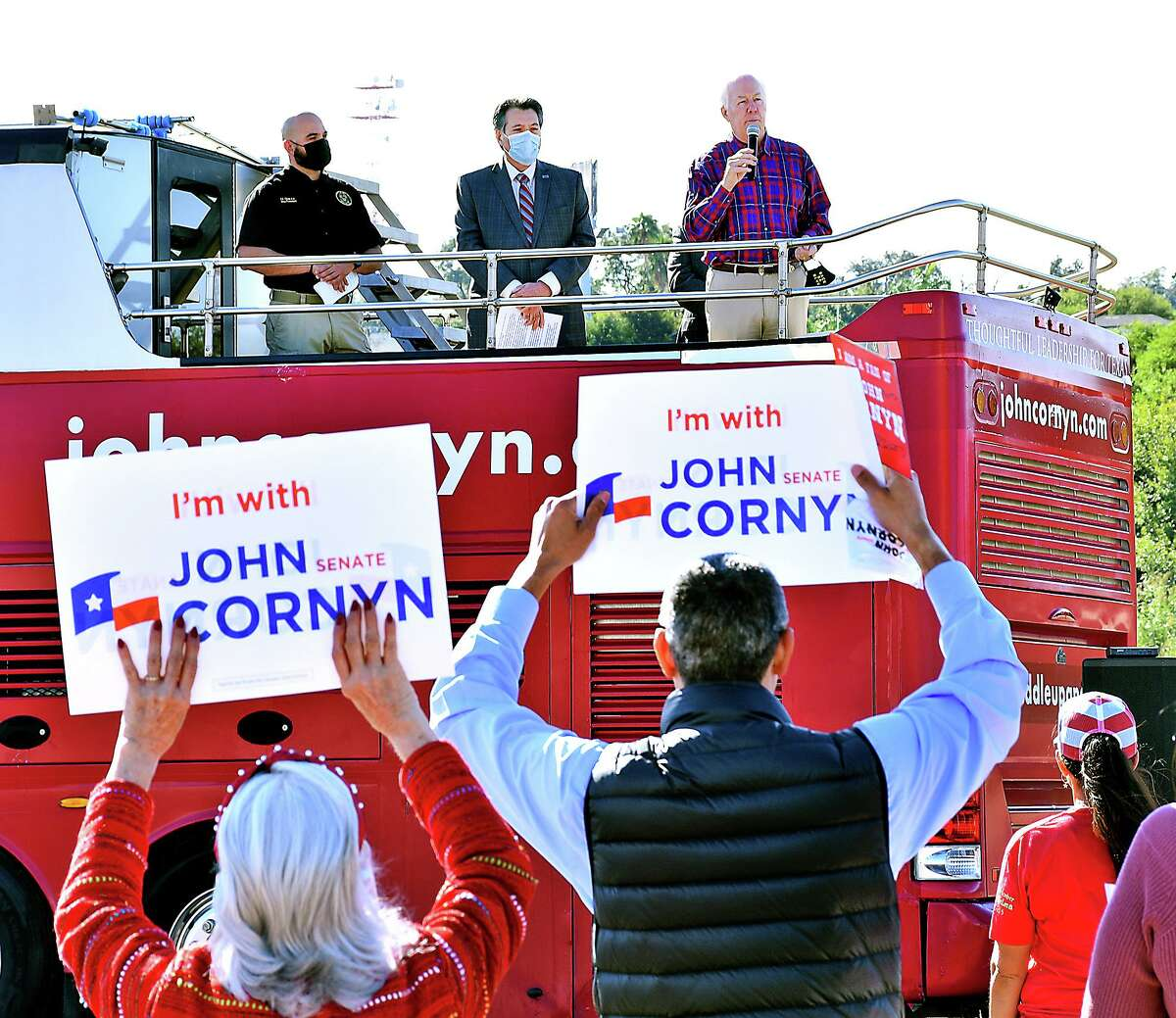 Senator John Cornyn, second from left, is accompanied by Laredo Mayor Pete Saenz, former LULAC National President Roger C. Rocha Jr., and Hector Garza, president of the National Border Patrol Council, Monday, November 2, 2020, as he stopped in Laredo, Texas for a get out the vote rally as he seeks re-election in the November 3, 2020 elections.