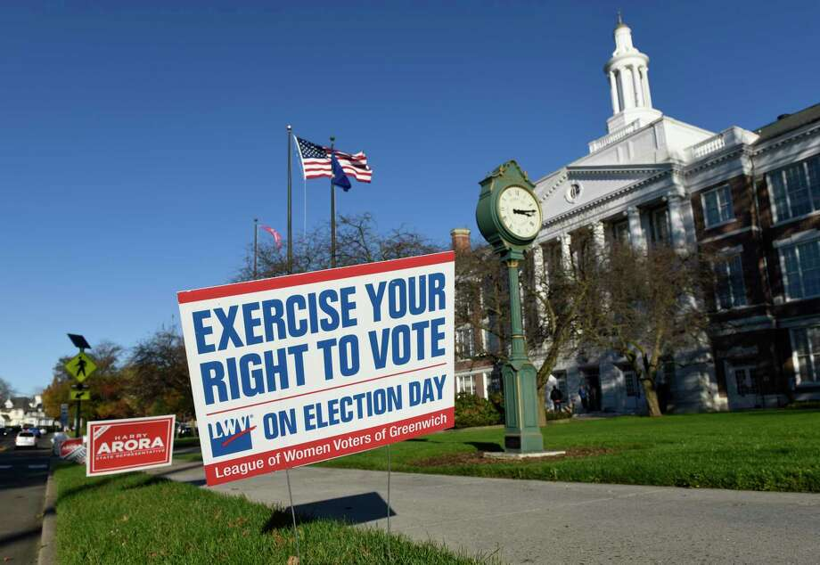 A League of Women Voters sign encourages participation in Tuesday's election outside the District 2 polling station at Town Hall in Greenwich, Conn. Monday, Nov. 2, 2020. Photo: Tyler Sizemore / Hearst Connecticut Media / Greenwich Time