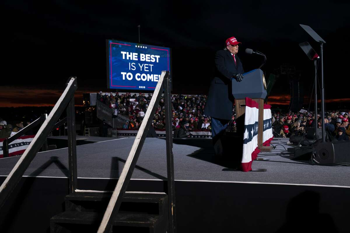 President Donald Trump speaks during a campaign rally at Cherry Capital Airport, Monday, Nov. 2, 2020, in Traverse City, Mich. (AP Photo/Evan Vucci)