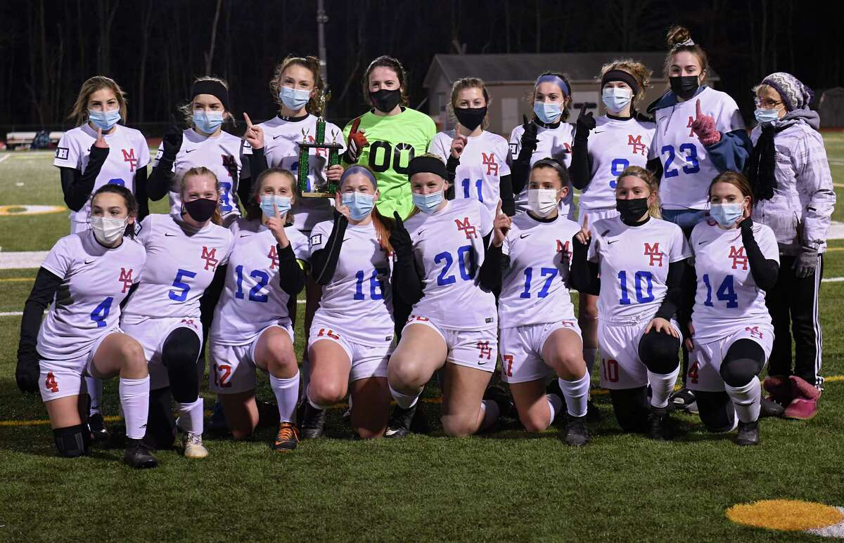 The Maple Hill team poses with the trophy after defeating Greenville during the Patroon Conference girls' soccer title game on Monday, Nov. 2, 2020 in Craryville, N.Y. (Lori Van Buren/Times Union)