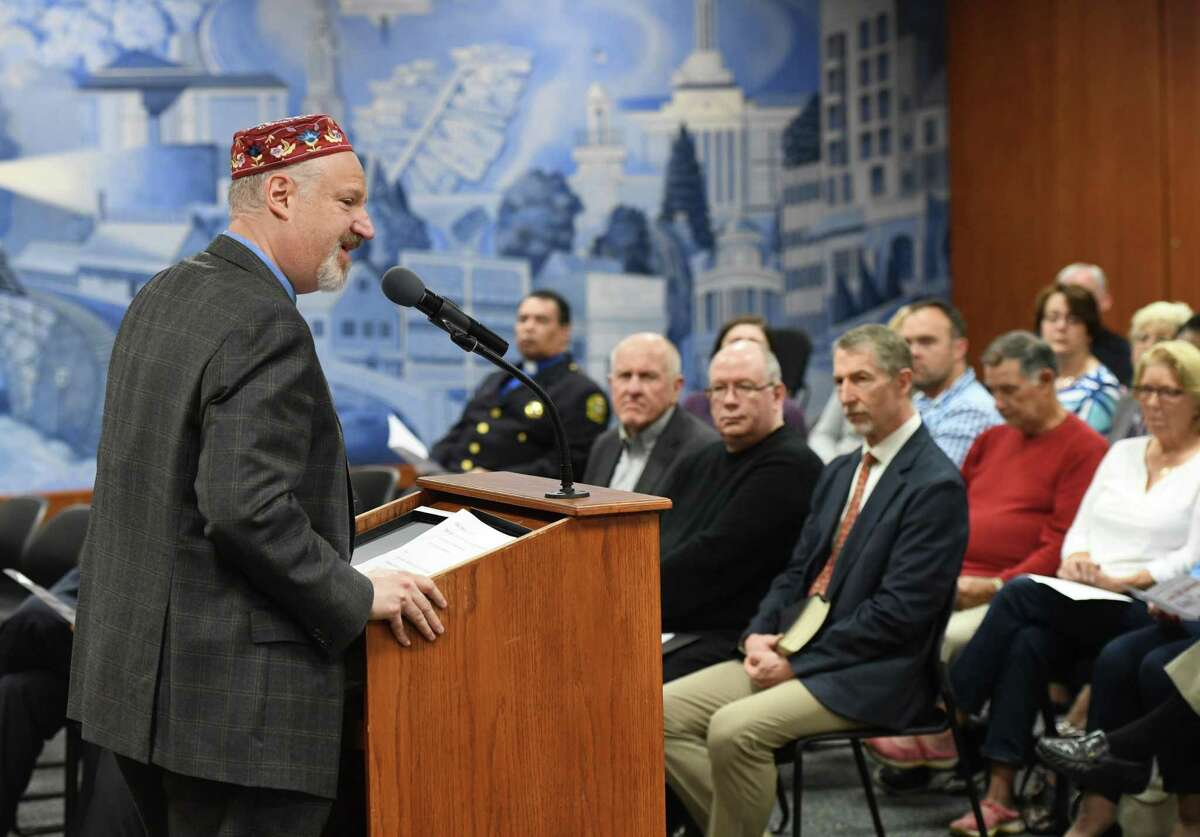 """Temple Sholom Rabbi Mitchell Hurvitz leads a prayer for education during the National Day of Prayer interfaith program at Town Hall in Greenwich, Conn. Thursday, May 2, 2019. The Town of Greenwich welcomed community religious leaders in a celebration of different religions through scripture readings and prayers for the nation, education, military, government, family, business and media under the theme """"love one another."""""""