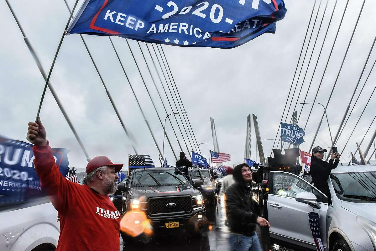 Trump supporters stop their vehicles and block traffic on the Tappen Zee Bridge also called the Governor Mario M. Cuomo Bridge on November 1, 2020 in Tarrytown, New York. With just two day left before the U.S. Presidential election, Trump supporters coordinated large caravans across the country dubbed