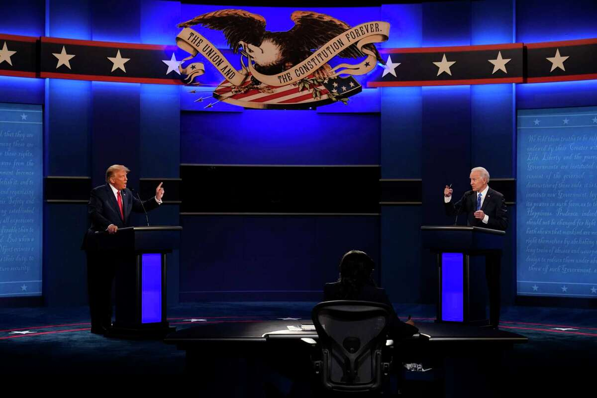 Bay Area parents and teachers are striving to help kids cope with the stress and anxiety stemming from the presidential contest between President Trump and former Vice President Joe Biden, shown here at their final debate at Belmont University in Nashville on Oct. 22.