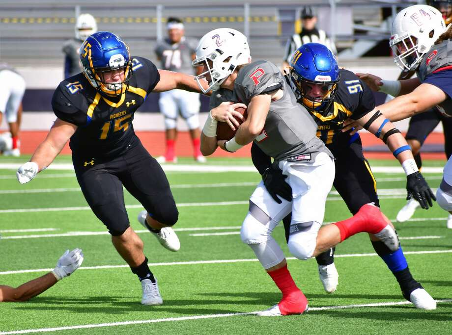 Wayland Baptist defenders Casey Buck (15) and William Humphrey take down Oklahoma Panhandle State quarterback KC Crandall during their non-conference NAIA football game on Oct. 31, 2020 in Greg Sherwood Memorial Bulldog Stadium. Photo: Nathan Giese/Planview Herald