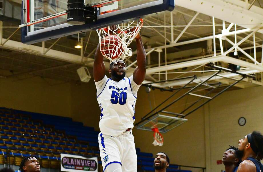Wayland Baptist's Chinedu Okonkwo throws down a slam dunk while a quartet of Arlington Baptist defenders look on during their non-conference NAIA men's basketball game on Oct. 30, 2020 in the Hutcherson Center. Photo: Nathan Giese/Planview Herald