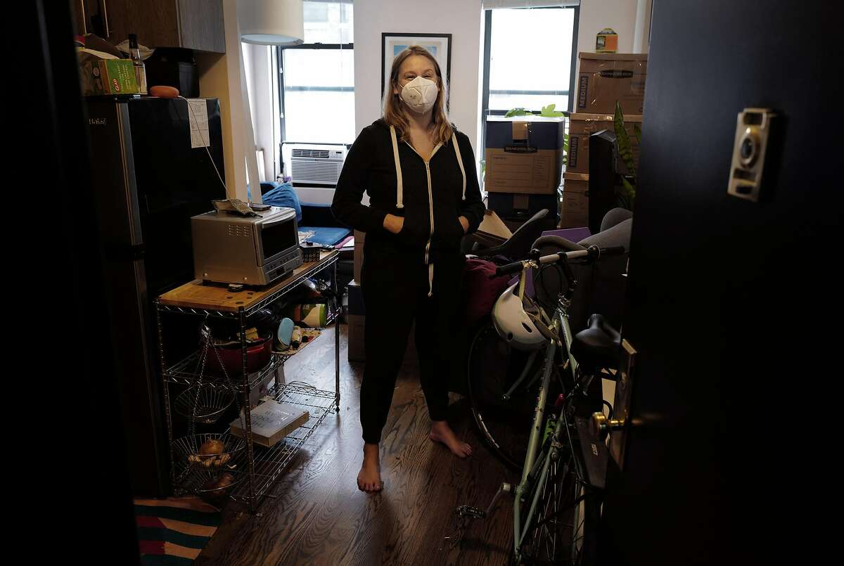 Anna Roth poses for a portrait on October 21, 2020 while packing to move to Seattle from her apartment in New York, New York.