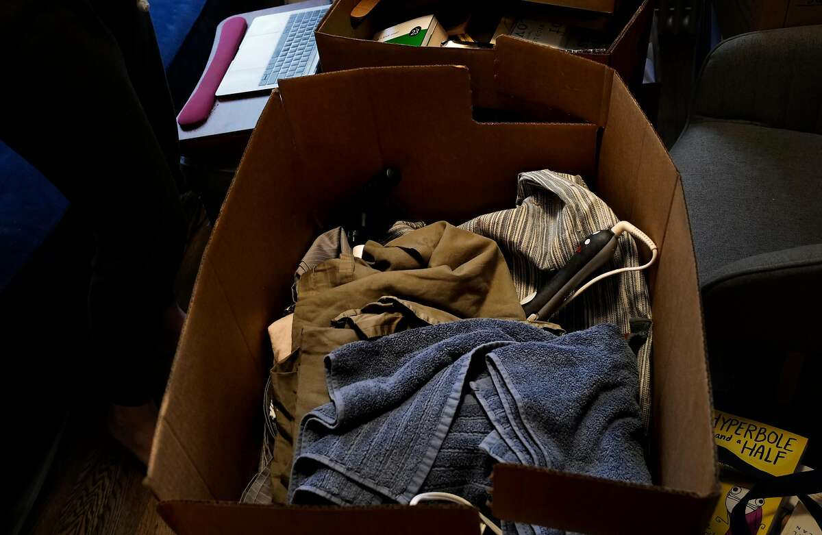 Anna Roth (out of frame) packs on October 21, 2020 for her move to Seattle from her apartment in New York, New York.