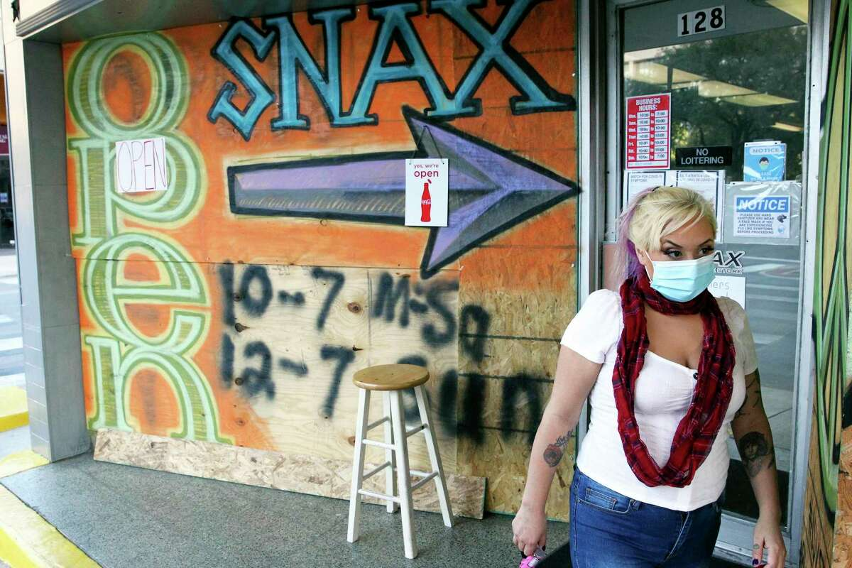 The SNAX shop off E Travis is boarded with plywood for Tuesday night as downtown businesses take precautions for the upcoming election night in San Antonio on Nov. 2, 2020.