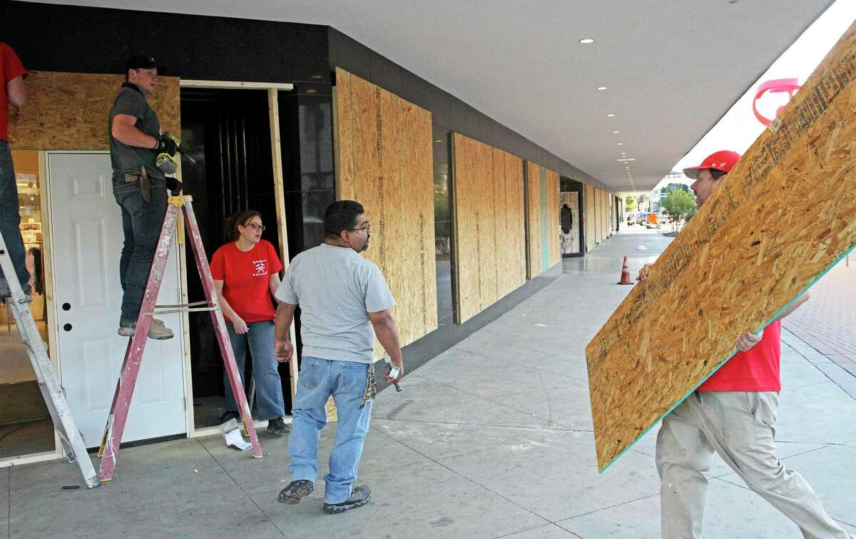 The H&M building is boarded up by a crew from My Handyman as downtown businesses take precautions for the upcoming election night in San Antonio on Nov. 2, 2020.