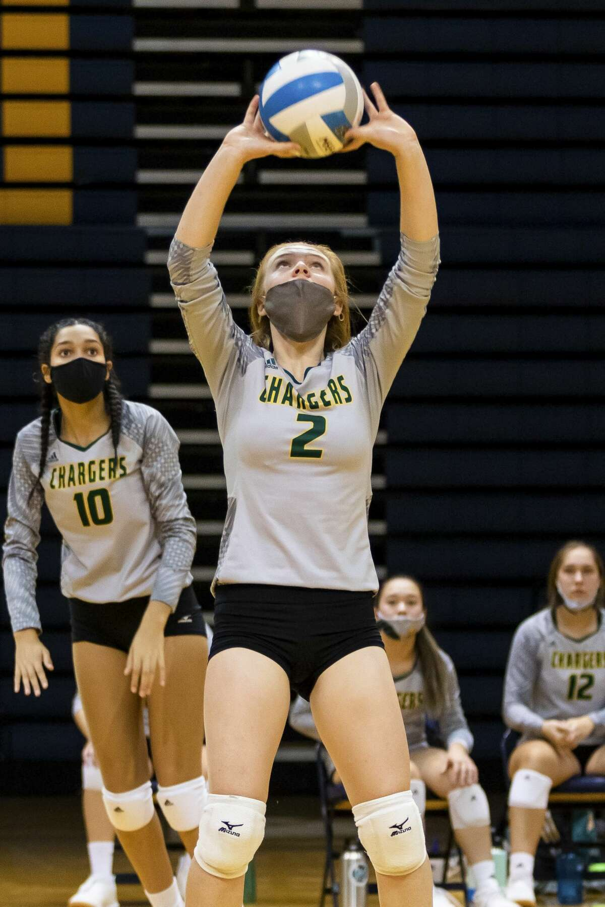 Dow's Alexa Kolnitys sets the ball during a match against Mount Pleasant Monday, Nov. 2, 2020 at Mount Pleasant High School. (Cody Scanlan/for the Daily News)