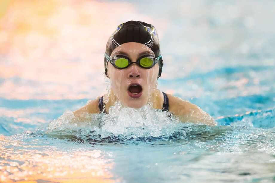 Midland's Addison Birchmeier competes in the 100 yard breaststroke during a swim meet against Dow Monday, Nov. 2, 2020 at H. H. Dow High School. (Katy Kildee/kkildee@mdn.net) Photo: (Katy Kildee/kkildee@mdn.net)
