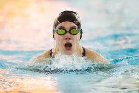 Midland's Addison Birchmeier competes in the 100 yard breaststroke during a swim meet against Dow Monday, Nov. 2, 2020 at H. H. Dow High School. (Katy Kildee/kkildee@mdn.net)
