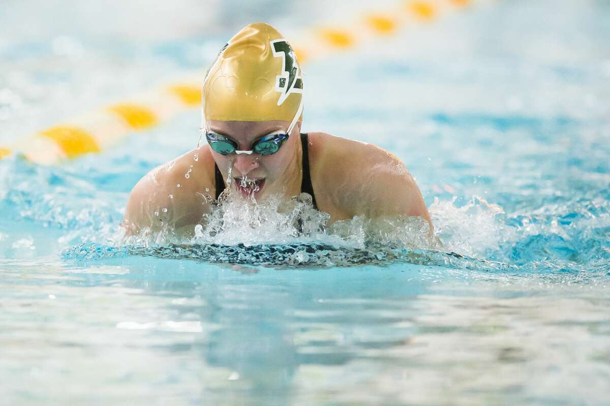 Dow's Lauren Burgard competes in the 100 yard breaststroke during a swim meet against Midland Monday, Nov. 2, 2020 at H. H. Dow High School. (Katy Kildee/kkildee@mdn.net)