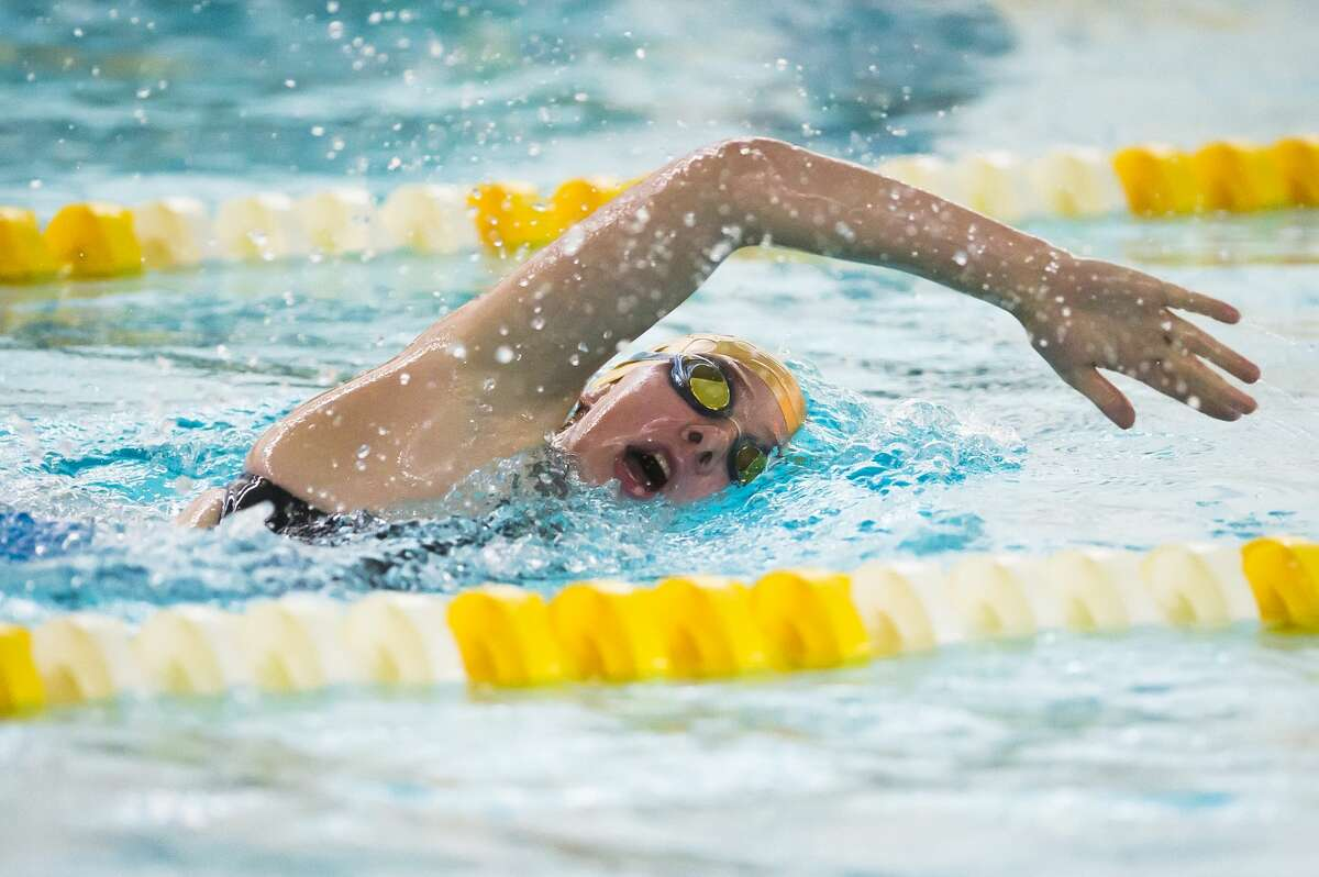 Dow's Mackenzie Thackery competes in the 500 yard freestyle during a swim meet against Midland Monday, Nov. 2, 2020 at H. H. Dow High School. (Katy Kildee/kkildee@mdn.net)