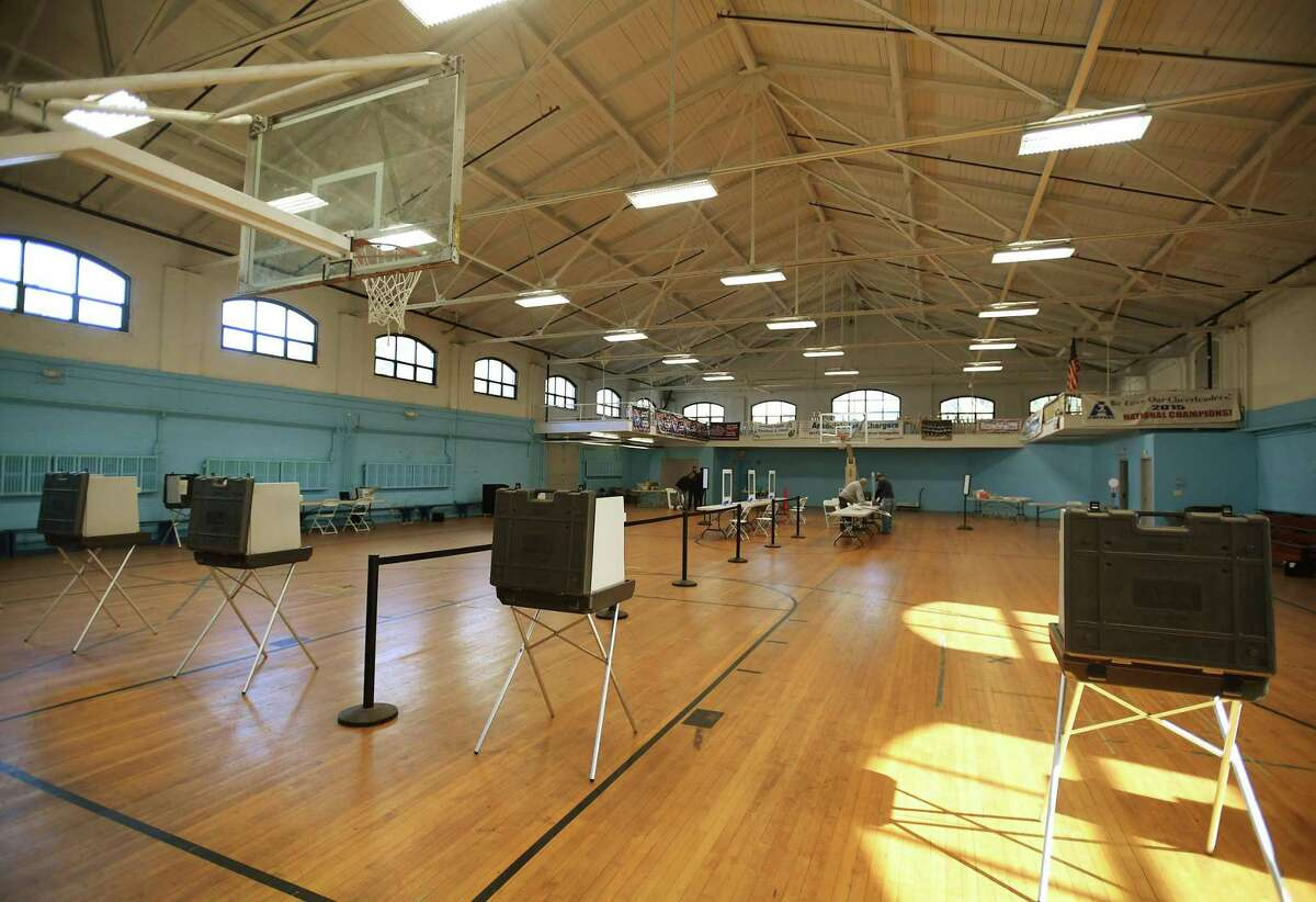 Voting stations are set apart in preparation for socially-distanced voting in the 2020 election at the Ansonia Armory on Monday, November 2, 2020.