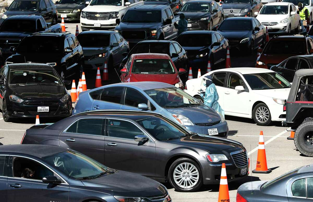 Vehicles line up in a parking lot in El Paso near the University of Texas campus for coronavirus testing on Thursday, Oct. 29, 2020.