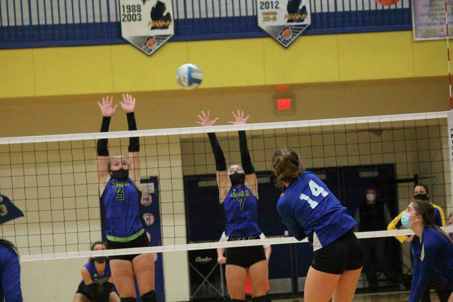 Morley Stanwood's Madison Garbow (3) and Aiyana Sims (7) go up for the ball against Beal City on Monday. (Pioneer photo/John Raffel)