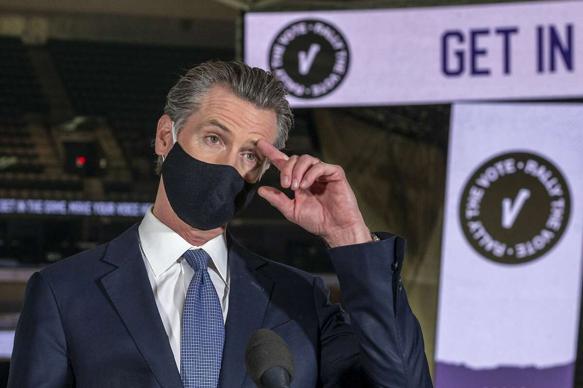 California Gov. Gavin Newsom speaks to reporters after voting under COVID-19 protocols at Golden 1 Center in Sacramento, Calif., Thursday, Oct. 29, 2020.