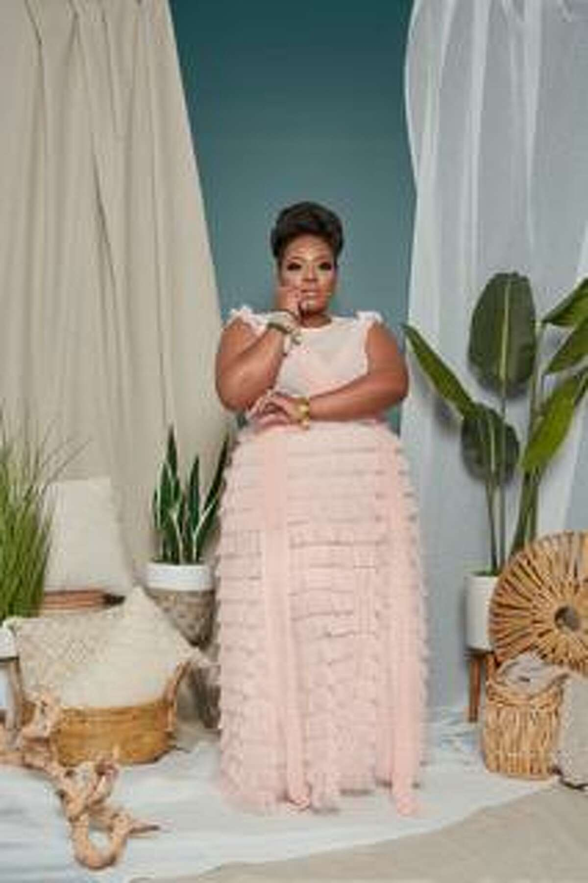 Martha Elmore Berry is the owner of Glam House, a photography studio in Humble, and the online store I'MarE Boutique which markets toward plus-size women looking for unique finds.