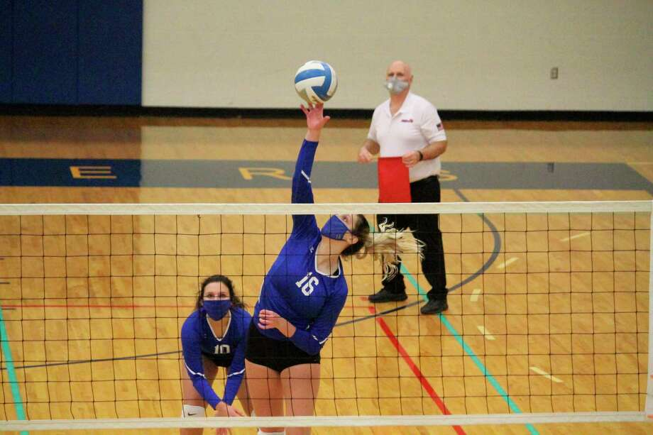 Sophie Wisniski leaps up to score a kill for the Portagers in their victory over Bear Lake on Nov. 2. (Photo/Robert Myers)