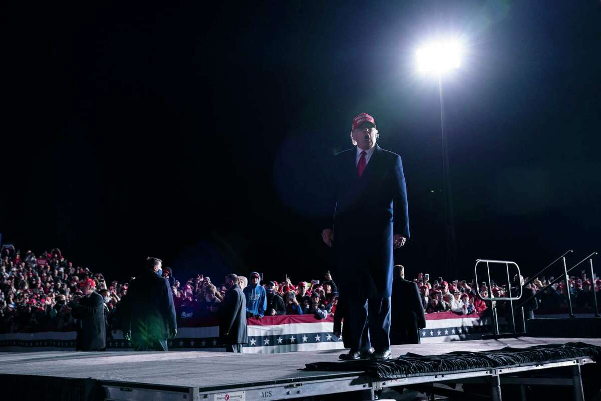 President Donald Trump walks off stage after speaking during a campaign rally at Richard B. Russell Airport, Sunday, Nov. 1, 2020, in Rome, Ga.