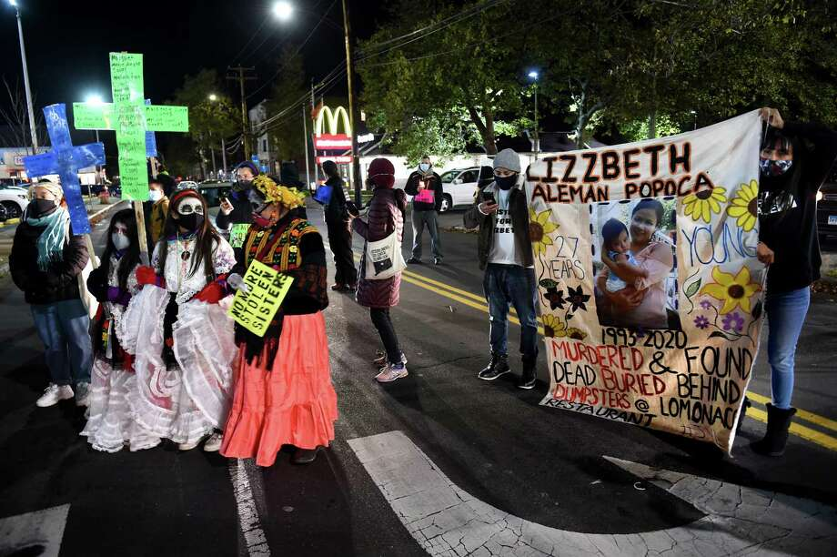 Members of the Justice for Lizzbeth Aleman-Popoca make a stop on Ferry Street in New Haven on November 2, 2020 during a Day of the Dead march in memory of Aleman-Popoca, who was killed in July and found in a shallow grave behind LoMonaco's Ristorante in Branford. Photo: Arnold Gold / Hearst Connecticut Media / New Haven Register