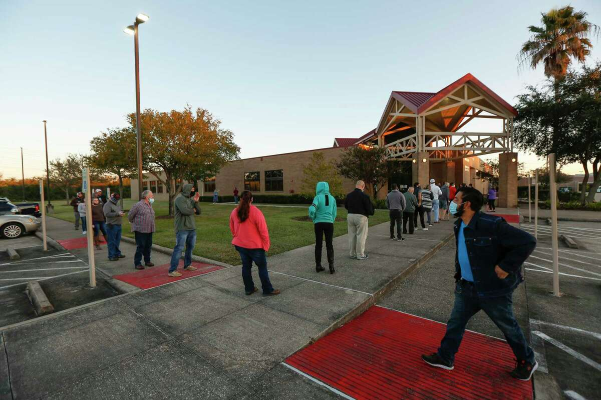 Voters arrive early and practiced social distancing at the Tom Reid Library Tuesday, Nov. 3, 2020, in Pearland.