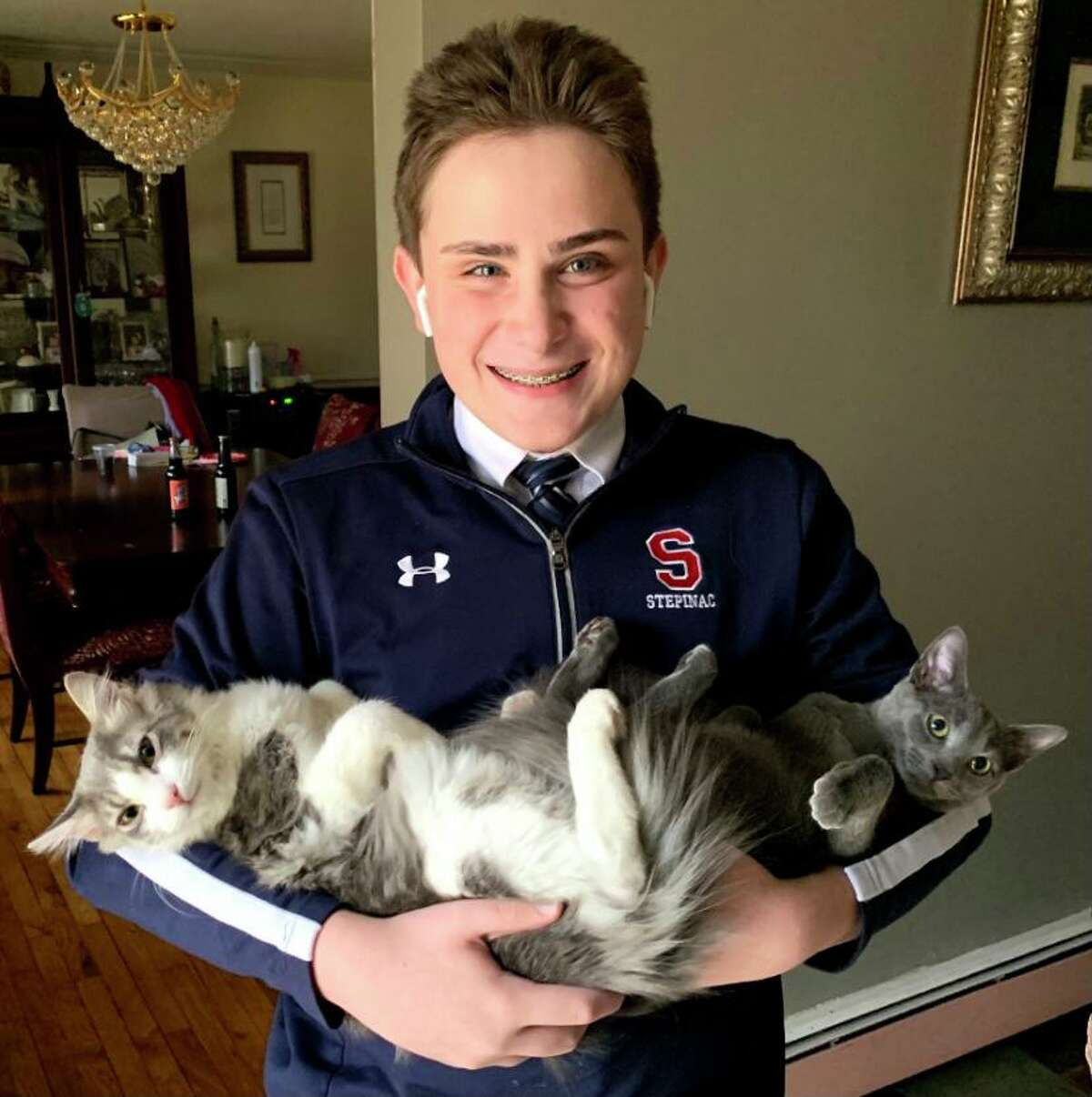Anthony Raduazzo with two of his family's cats, Pluto and Luna.