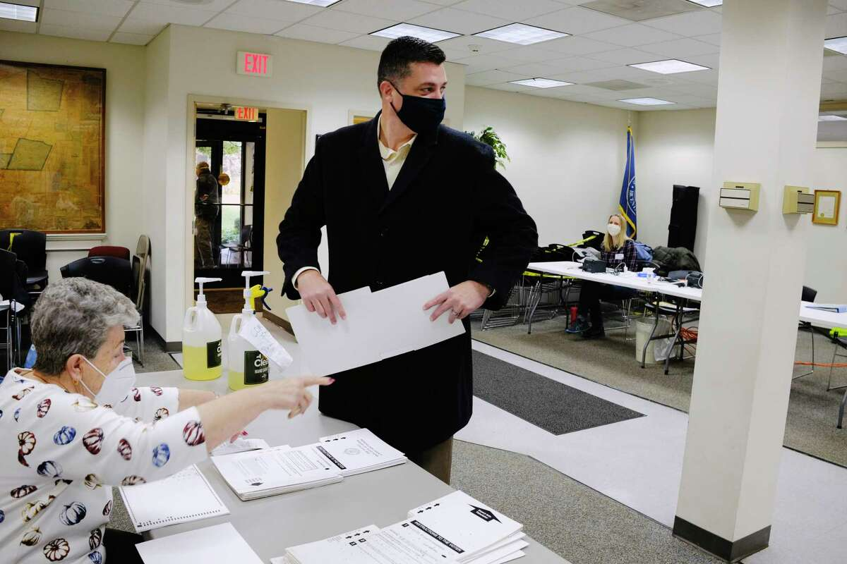 Assemblyman Jake Ashby receives his ballot as he votes at Schodack Town Hall on Tuesday, Nov. 3, 2020, in Schodack, N.Y. (Paul Buckowski/Times Union)