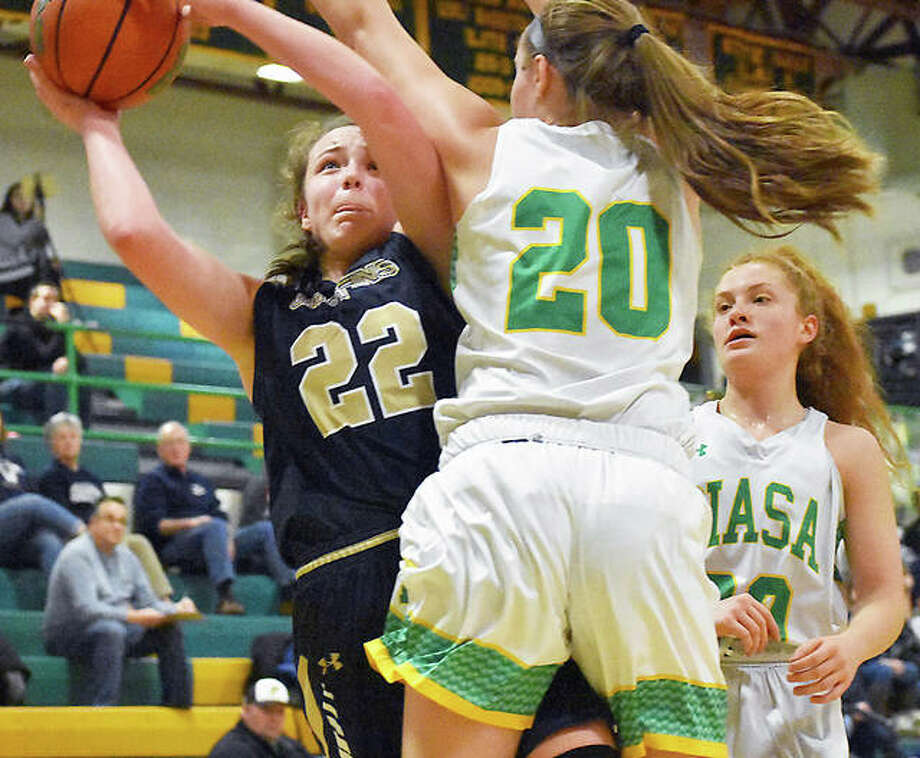 Father McGivney forward Charlize Luehmann, left, attempts to put up a shot with Southwestern's Korrie Hopkins guarding her in the second quarter of a game last season in Piasa. Photo: Matt Kamp|The Intelligencer