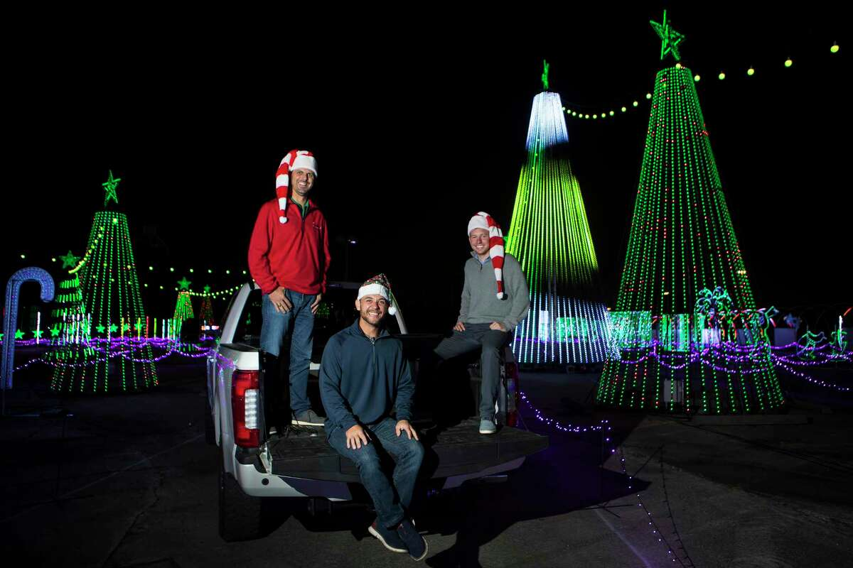 Matt Johnson, left, Jasen Coots and Joe White, co-creators of The Light Park, a new drive-through holiday experience pose for a portrait in the park on Monday, Nov. 2, 2020 in Spring. The attractions include a 700-foot long animated LED tunnel. All told, the park boasts more than 1 million LED lights for a one-mile show that is synched and choreographed to holiday music on a dedicated station.