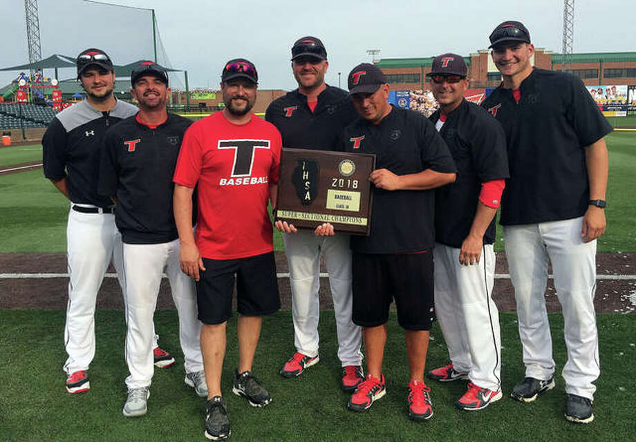 Edwardsville graduate Jesse Bugger, middle, poses with other members of the Triad coaching staff after the Knights beat Chatham Glenwood 8-0 in the Class 3A Sauget Super-Sectional at GCS Ballpark in 2018. Photo: For The Intelligencer