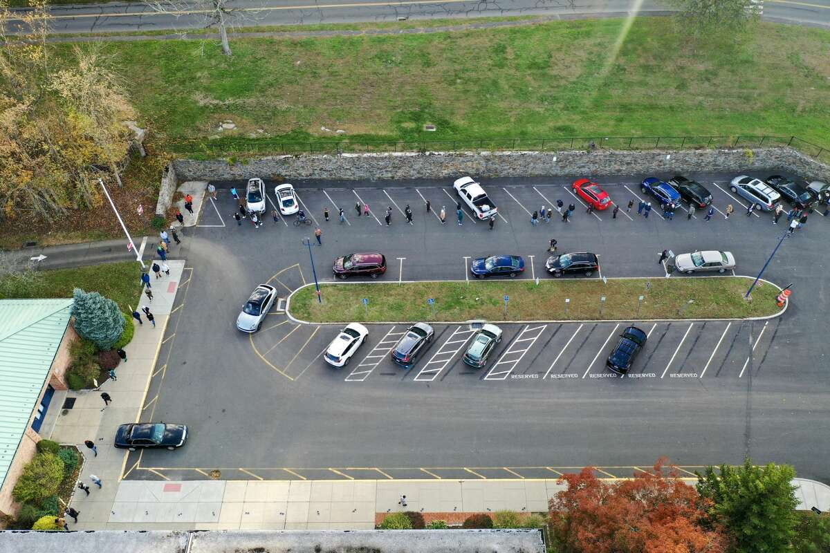 Wolfpit Elementary School polling site in Norwalk on Nov. 3, 2020. At Wolfpit Elementary on Starlight Drive, voters were waiting in a lengthy line that stretched through the parking lot and onto the street. Drone photos captured the long line from above.
