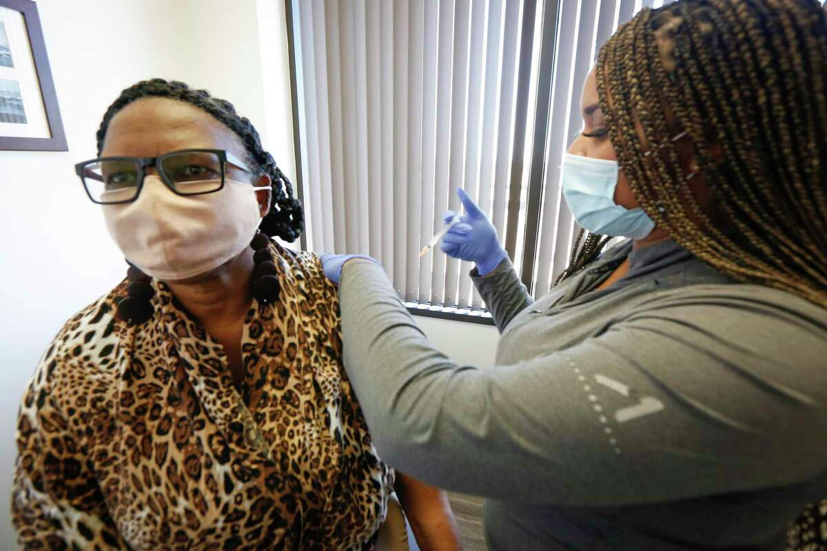 Xandra Williams-Earlie receives her flu shot by Candace Mabins in Dr. Gary Sheppard's office Friday, Oct. 30, 2020, in Houston.