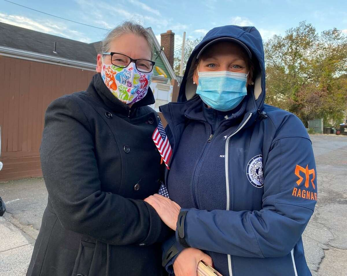 Donna Barfield, left, and Carol Barfield wait to vote in New Haven's 17th Ward on Tuesday, Nov. 3, 2020.
