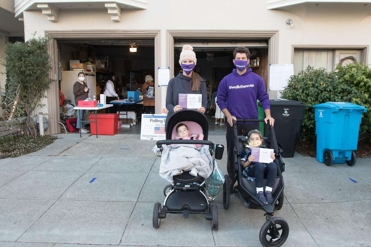 The family made their own parade as they walked together to the nearby poll location on Webster Street in the Marina District to drop off their mail-in ballots in person at the location. The lack of in-person voters at Election Day poll locations was evident throughout the city.
