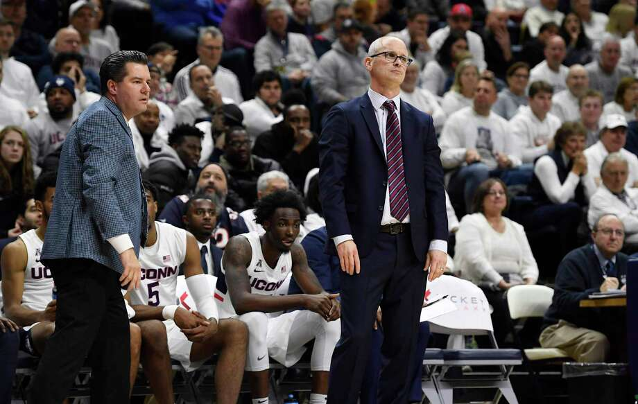Connecticut head coach Dan Hurley, right, and assistant coach Tom Moore react during the first half of an NCAA college basketball game, Sunday, Nov. 17, 2019, in Storrs, Conn. (AP Photo/Jessica Hill) Photo: Jessica Hill / Associated Press / Copyright 2019 The Associated Press. All rights reserved